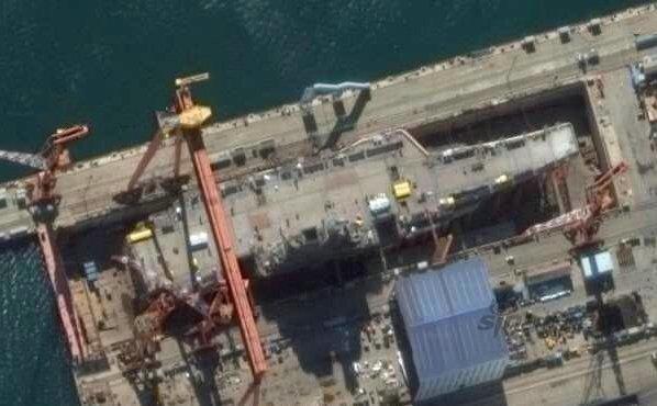 外媒:中国航母建造大提速 南北同时造三艘巨舰