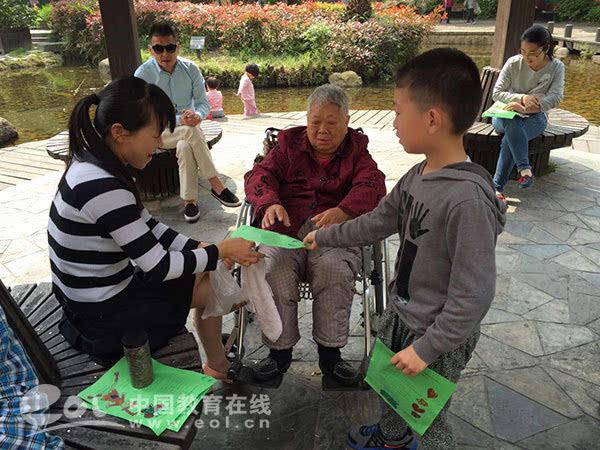 """绿洲花园幼儿园开展""""喜迎g20 画出家乡美""""爱国卫生百日大行动图片"""