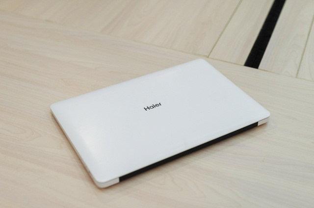 简爱��.i�l>[�s�Z�_14寸纯白苹果本 海尔n1401简爱笔电评测