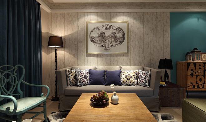 沙发背景墙上的抽象画让白色墙面变得亮堂,雅致起来,而且在色彩上