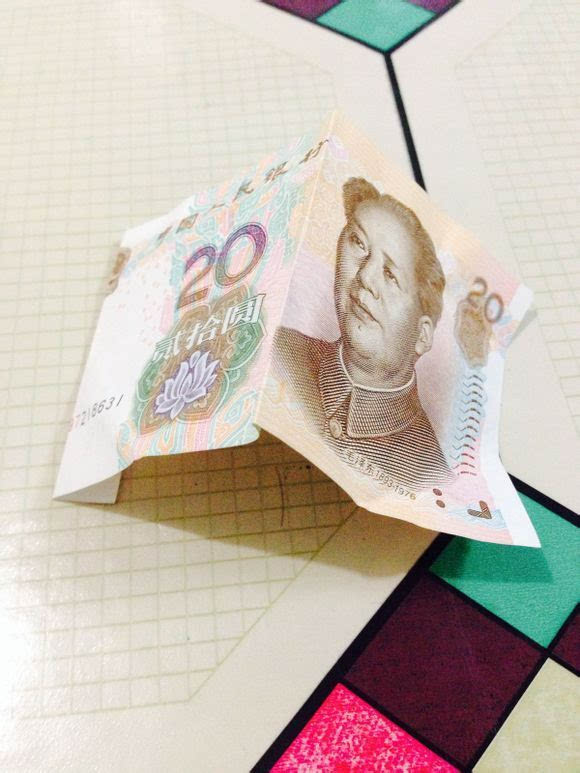 人民币520心形折纸手工折法教程图解 50,20,10元币