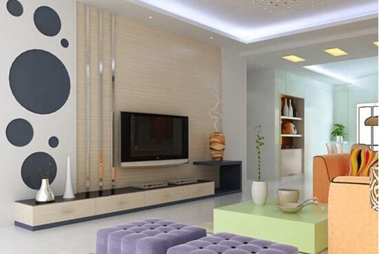 客厅电视机背景墙效果图三   客厅电视机背景墙作为客厅装饰的一部分,它在色彩的把握上一定要与整个空间的色调相一致。堪舆学中有一种说法,如果电视背景墙色系和客厅的色调不协调,不但会影响感观,还会影响情绪。