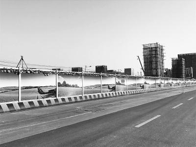 施工便道上周铺装 光谷大道通行改善