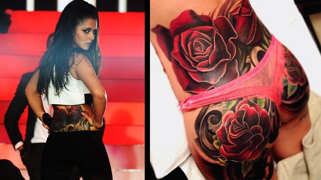 但身上的纹身却暴露出她是一个超性感的尤物,臀部处的玫瑰花纹身美得